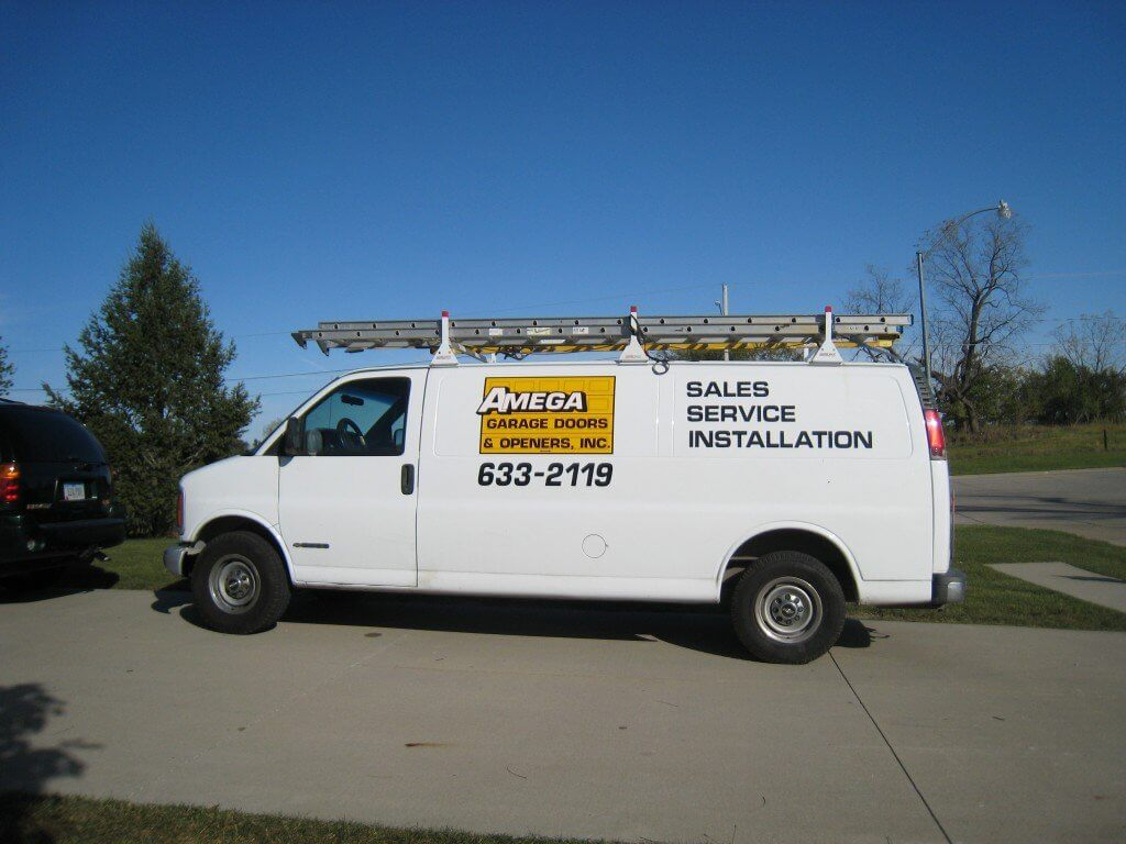white garage door repair service van