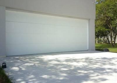 Steel Flush Panel Residential Garage Door in White