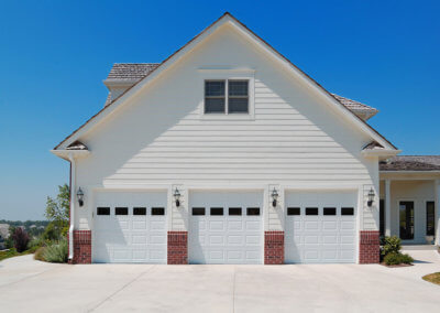 Raised Panel Garage Doors on a Three-Car Garaage