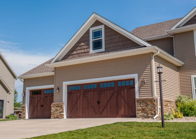 Flush Panel Garage Door with Wrought Iron Hardware
