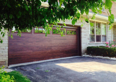 Steel Garage Door in Mahogany Accents Woodtones
