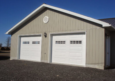 Steel Raised Panel Garage Door in White with Stockton Windows